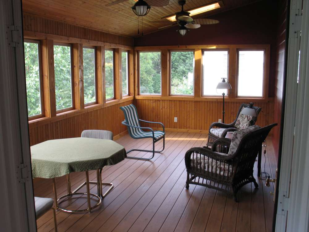 Interior view of an all season porch on top of a basement workshop.